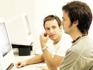 two guys using a computer