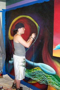 Jordan Dubois works on the mural he created with his twin brother, Justin, at the Flanagan Campus in Lincoln.